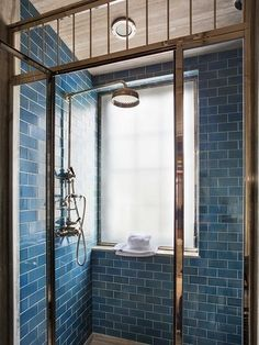 thefoodogatemyhomework:  Ocean blue subway tile in this perfect shower in a Hamptons bathroom by Steven Gambrel.