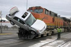 Train gets Cadillac Hood Ornament after skewering Car Carrier