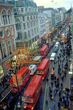 Oxford Street in London, England, at Christmastime. Oxford Street is not anywhere near the city of Oxford -which is about 60 km north west of London- and is a major thoroughfare in the West End. Oxford Street is one of Europe's busiest. Places Around The World, Oh The Places You'll Go, Places To Travel, Around The Worlds, Oxford Street London, London City, Streets Of London, London Shopping Street, London Pubs