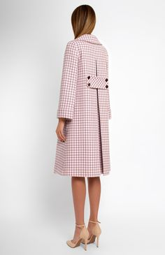 A-shape genuine wool coat finished with cotton velvet buttons. Turndown collar. Back box pleat. Patch pockets.