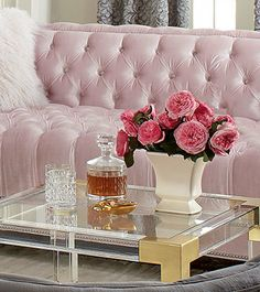 pretty pink sofa  with pretty flowers. http://rstyle.me/n/n6rjepdpe