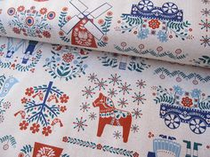 fabric designed by The Dutch Door Press of San Francisco for Kokka of Japan features Dala horses, hot air balloons, windmills, birds, hearts, and so many more Dutch/Scandinavian motifs. The colors are traditional yet current - red, navy, and teal.