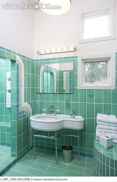 BATHROOM: ART DECO STYLE green tile walls and floor, geometric green tile…