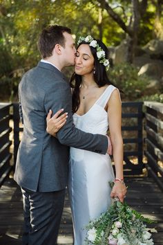 Rustic bridge, sweet moment, kiss, embrace, wooded area