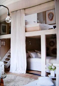 It's like bunkbeds with a canopy feel, or like sleeping in a train. I really enjoy the use of space and creation of the illusion of complete privacy