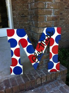 Ole Miss Polka Dot Door Hanger EXCEPT I would change colors to maroon and white and put Mississippi State! Other than that, it's cute!