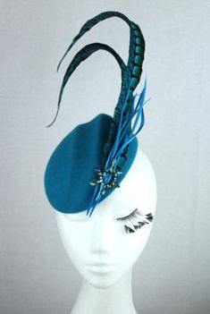 Teal wool felt fascinator with teal pheasant feather, biot feather and real fresh water blue pearl accents.