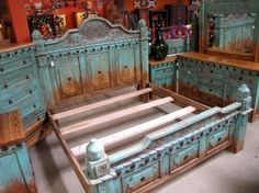 Southwest style pine bed with turquoise distressed finish. Curved top headboard, carved detailing and conchos give it lots of rustic elegant character.