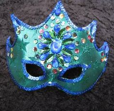 masquerade party favour. (everyone chooses one to wear to reception/ball and gets to take it home after)