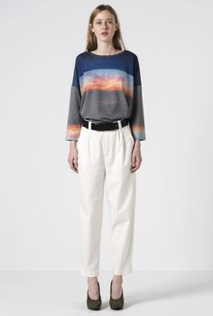 Balusan is a printed sweater with a transparent shoulder panel achieved by burn-out printing, while a digital photo print of an horizon at sunset covers the body. The imagery and double techniques make this nature prin...