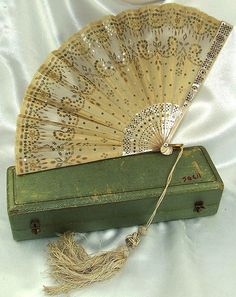 Antique French Mother of Pearl & Gold Sequins Fan in original Box, 1845. Fans were carried as an accessory but also as a means of communication. There is a fan language for flirting since couples couldn't openly express their love.