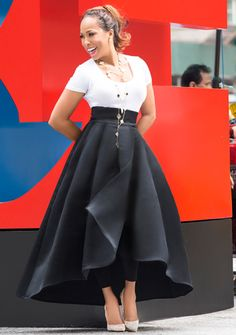 Marjorie Harvey is wearing a Christian Dior runway skirt and Christian Louboutin Pigalle pumps.