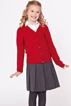 Top Class Girls Cardigans (2pk), from €17 ; Top Class Pleated Skirt (2pk), from €12 at Littlewoods