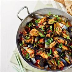 Red Thai spicy mussels. This recipe uses Thai red curry paste to keep prep to a minimum.
