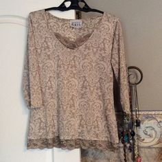 Taupe 1/4 sleeve T-Shirt Dark and Light Shades of paisley print with taupe lace at V of collar and around bottom hemline. Tops Tees - Long Sleeve