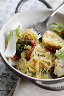 Roasted Spaghetti Squash with Greens, Artichokes and Pomegranate