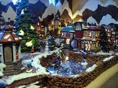 Check out this Christmas Village Alcove display by Christine Gortzig, complete with mountains, bricks, and ice skating. Department 56 Christmas Village, Christmas Village Display, Christmas Village Houses, Halloween Village, Christmas Villages, Christmas Decorations, Christmas In The City, Christmas Scenes, Christmas Love