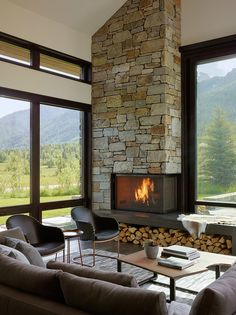 Stone Corner Fireplace Design Living Room big windows like yours are painted black for a graphic effect. Picture big blinds instead of curtains. Modern smal chairs room ideas with fireplace Top 70 Best Corner Fireplace Designs - Angled Interior Ideas Home Fireplace, Living Room With Fireplace, Fireplace Design, Fireplace Ideas, Fireplace Modern, Corner Fireplaces, Modern Stone Fireplace, Fireplace Furniture, Stone Wall Living Room