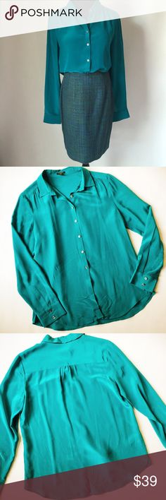 "Ann Taylor Silk Button Down Top Ann Taylor Silk Button Down Top in teal featuring a rich jewel tone in a classic wardrobe staple.  Layer with a blazer for work or with a leather moto jacket for date night!  True color in first pic.  Pre-loved but in excellent condition.  Slight signs of everyday wear, see pics.  No other holes, tears or damage.   Measurements laying flat: Armpit to armpit: 20"" Waist (across): 20.5""  Total length: 26""  Sleeve length: 24"" Ann Taylor Tops"