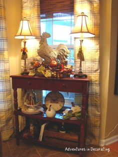 Examples of French Country Decor | this stone rooster is a great focal point for this country vignette