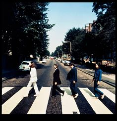 Extremely rare photo of the Beatles, walking 'the wrong direction' on Abbey Road.  Paul has sandals on.