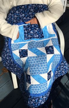 """Picture only - Wheel Chair Lap Quilts with pockets.The size of the lap quilt is 32"""" x 39.5"""". quilt with two pockets, one through pocket to keep your hands warm and the other for items you would like close at hand.  The pockets are both lined in flannel as well as the back of the quilt.  Can make my own or Go to site to buy pattern or quilt..."""