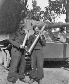Waffen SS Tiger 1 crew members posing with a British 6 pounder and their own shell.