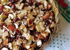 APPLE CRISP BAKED BRIE - 8 oz round Brie cheese • 1 Fuji apple, diced • 1/2 cup dried, sweetened cranberries • 1/4 cup packed light brown sugar • 1/2 tsp cinnamon • 1/4 tsp nutmeg • 1/8 tsp salt • 3 oz slivered almonds • 3 tbsp butter