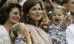 'Well done daddy!' Roger Federer's adorable twin daughters cheer as their father takes his seventh singles title at Wimbledon