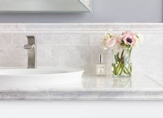A serene, oasis-like primary bath calls for delicate tile. The Meram Blanc marble collection is subtle and striking all at once. It's no wonder it's a customer favorite!  Tiles featured: Meram Blanc 8x18 in., Meram Blanc Barnes, + Meram Blanc Somerset. Bathroom Tile Designs, Bathroom Design Small, Bathroom Interior Design, Marble Wall, Wall Tiles, Marble Floor, Upstairs Bathrooms, Master Bathroom, Bathroom Wall