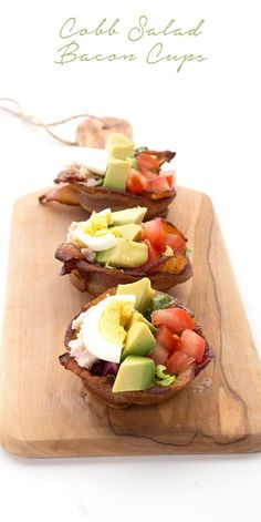 Fun little keto appetizers! Bacon Cups filled with Cobb Salad for a fun low carb twist on a California classic recipe. #lowcarb #keto #bacon #cobbsalad  via @dreamaboutfood