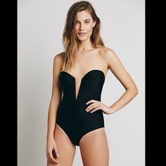 "Free People Beach Riot black Caesar 1 pc S Free People / Beach Riot black ""Caesar One Piece""  American made strapless one piece bathing suit with a plunging V-wire neckline and molded, padded cups. Elastic straps in back feature adjustable hook and eye closures. A classic and glamorous silhouette.  *By BeachRiot  NWOT  *  Size:  Small  *there is a black line through the tag to prevent store return * the panty lining is still intact, this bathing suit was never tried on   *80% Nylon *20%…"