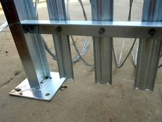 A corner of palisade fence, the RSJ palisade post with base plate stands on the… Palisade Fence, Plate Stands, Beams, Entryway Tables, Concrete, Corner, Furniture, Home Decor, Decoration Home