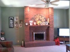 Living Room With Red Brick Fireplace red brick fireplace and green walls, just like our den | interior