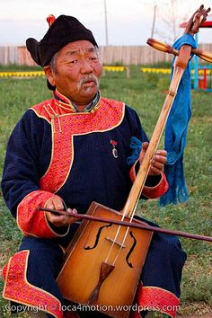 Playing the horse-head-fiddle. Mongolia: the Bradt Guide; www.bradtguides.com