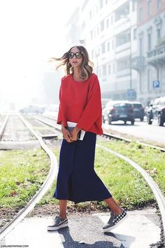 Skirts and Sneakers are a Trend—Here's How to Master it | StyleCaster black tee and long sleeved grey jumper
