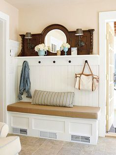 I love the darker mantlepiece above the white bench.  Pegs in the same stain unify the look.  Bench would have to have storage cubbies underneath to be useable.