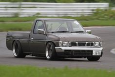 Caged Datsun Hardbody Pickup built by Garage Miniz, usually they're build boast a but dont know if this is one of them. Nissan Pickup Truck, Nissan Trucks, Toyota Trucks, Pickup Trucks, Nissan Life, Nissan Vans, Drift Truck, Nissan Hardbody, Lowrider Trucks