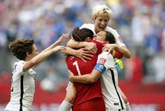 Jul 5, 2015; Vancouver, British Columbia, CAN; United States midfielder Carli Lloyd (10) celebrates with goalkeeper Hope Solo (1), midfielder Megan Rapinoe (15) and defender Meghan Klingenberg (22) after scoring against Japan during the first half of the final of the FIFA 2015 Women's World Cup at BC Place Stadium. Mandatory Credit: Michael Chow-USA TODAY Sports - RTX1J51J