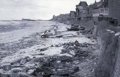 Pictured here is the aftermath of a US Fighter Aircraft that had crashed down along the waterfront of Juno Beach sometime after Canadian forces had landed on a Juno Beach D-Day landing zone in Saint-Aubin-sur-Mer, France. It was taken on 6 June 1944.