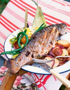 Thyme and red onion lend delicate flavors to fresh trout cooked over an open fire.