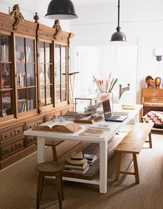 A Dining Table: In the library of a California home, a large table serves as both a desk and formal eating area.