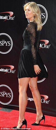 Fashion champion: Tennis star Maria Sharapova displayed her statuesque figure in a leg-bar...