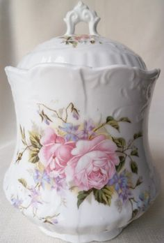 Pink rose biscuit or cookie jar. Add two more in similar design and you have a canister set for the kitchen!