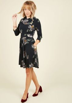 Sometimes a dress is so magical, it makes you long for somewhere special and new to wear it. With stylish touches like a foldover collar, 3/4-length sleeves, and decorative buttons, this deep, muted navy floral frock steals all the attention away from the sights on your tour. Check out this dashing design in a host of other haute hues and styles!