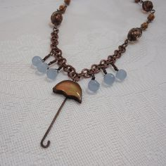 """18.5"""" Raindrops and Umbrella Necklace by TreasuresfrmtheHeart on Etsy, $45.00 April showers bring May flowers! You can be ready for the spring rains with this adorable necklace. The inspiration came from the Jade Scott, copper and resin umbrella pendant, and of course with an umbrella you need rain drops. What a cute necklace to help celebrate the arrival of spring.  Umbrella Pendant - 2"""" x 3/4"""""""