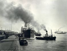 Another of Edward Chambre Hardman's iconic portraits of Liverpool entitled: 'A ship being pulled out from the Pier Head'