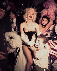 Marilyn Monroe photographed at the Ringling Brothers Circus Charity Gala at Madison Square Garden, March 30th 1955.