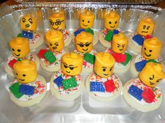 "An easy Birthday treat for the Lego Lover in your life.    Heads are made from Large marshmellows with smarties ""glued"" to the top with frosting.  Once dried, dip into melted yellow chocolate, and with a toothpick make the face.  The Legos are made from fondant."