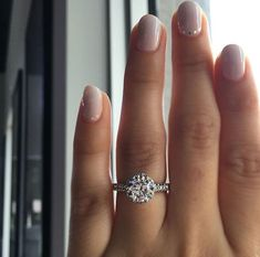 a beautiful diamond halo engagement ring setting from Tacori in white gold #tacoriengagementrings